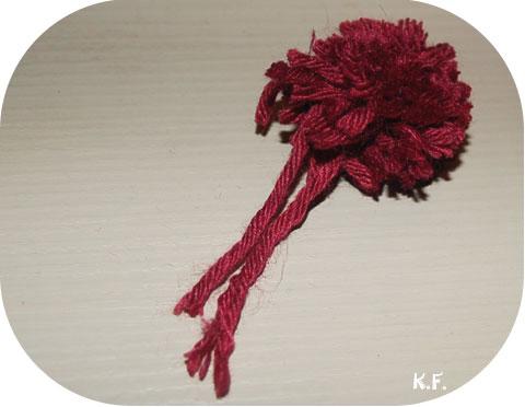 Etape 9: guirlande de pompons avec une fourchette