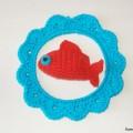 Cadre avec poisson rouge au crochet
