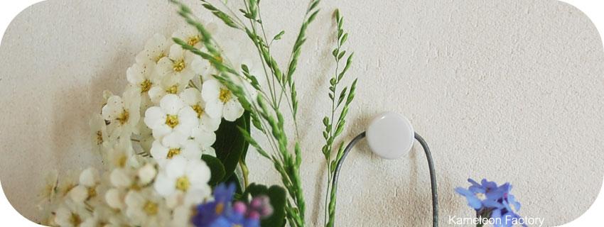 détail attache ampoule vase à fleur