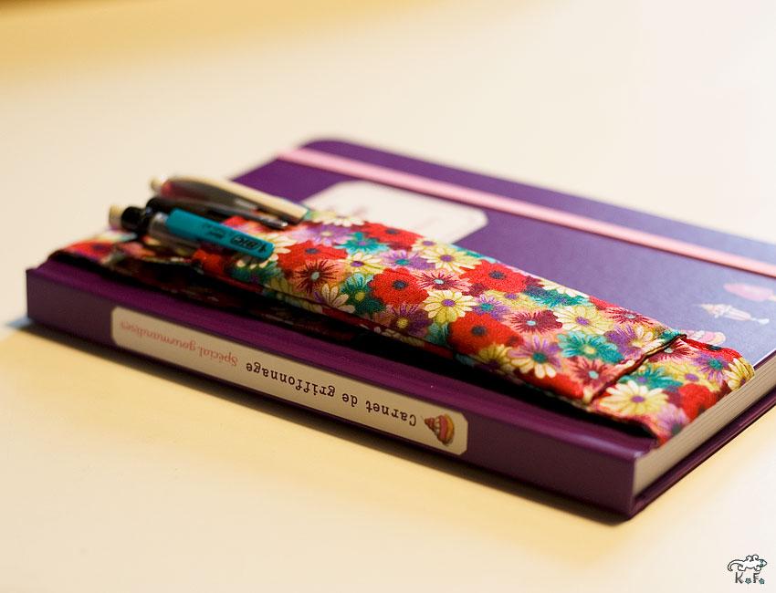 Porte crayon réglable pour s'adapter sur les carnets